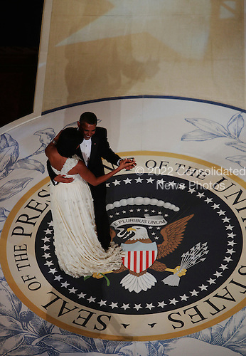 Washington, DC - January 20, 2009 -- United States President Barack Obama dances with First Lady Michelle Obama at the Commander-In-Chief's Inaugural Ball January 20, 2009 in Washington, DC. .Credit: Mark Wilson - Pool via CNP