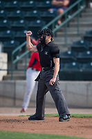 Home plate umpire Matt Herrera calls a strike during a Pioneer League game between the Missoula Osprey and the Orem Owlz at Ogren Park Allegiance Field on August 19, 2018 in Missoula, Montana. The Missoula Osprey defeated the Orem Owlz by a score of 8-0. (Zachary Lucy/Four Seam Images)