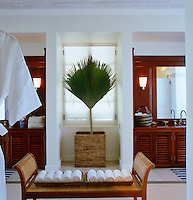 The bathroom is one of several made from local mahogany and original to the property