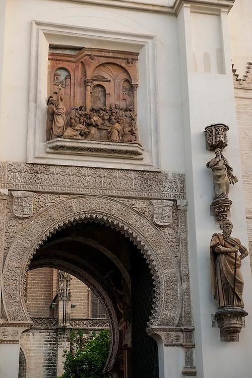 Ornate facade of the entrance to Real Alcazar in Sevilla.