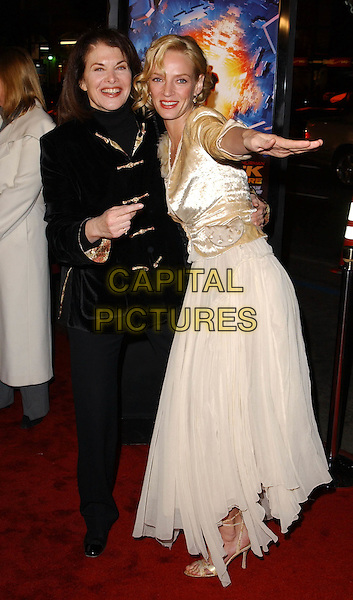 SHERRY LANSING & UMA THURMAN.L.A. Premiere of Paycheck held at The Graumann's Chinese Theatre in Hollywood .18 December 2003 .*UK Sales Only*.full length, full-length, funny                                                    .www.capitalpictures.com.sales@capitalpictures.com.©Capital Pictures.
