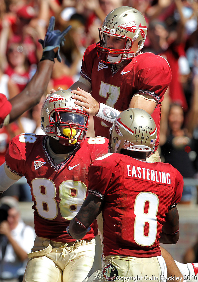 TALLAHASSEE, FL 10-FSU-BC FB10 CH-Florida State's Christian Ponder, top, celebrates with Beau Reliford after Reliford caught the 10-yard pass he threw against Boston College during first half action Saturday at Doak Campbell Stadium in Tallahassee. .COLIN HACKLEY PHOTO