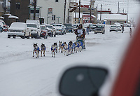 Bob Bundtzen runs up front street in Nome on Friday March 14 during the 2014 Iditarod Sled Dog Race.<br /> <br /> PHOTO (c) BY JEFF SCHULTZ/IditarodPhotos.com -- REPRODUCTION PROHIBITED WITHOUT PERMISSION