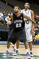 January 14, 2010:    Lipscomb forward Brian Wright (23) tries to block out Jacksonville forward Ayron Hardy (10) for a rebound during Atlantic Sun conference game action between the Jacksonville Dolphins and the Lipscomb Bisons at Veterans Memorial Arena in Jacksonville, Florida.  Jacksonville defeated Lipscomb 79-73.