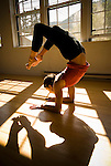 A young woman practices yoga at a studio in Jackson, Wyoming.