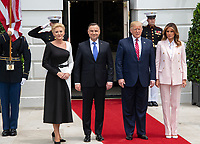 United States President Donald J. Trump, right center, and first lady Melania Trump, right, President Andrzej Duda of the Republic of Poland, left center, and his wife, Agata Kornhauser-Duda, left, pose for a group photo as they are welcomed to the South Lawn of the White House in Washington, DC on Wednesday, June 12, 2019. <br /> Credit: Ron Sachs / CNP/AdMedia
