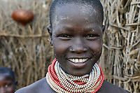 ETHIOPIA, Southern Nations, Lower Omo valley, Kangaten, village Kakuta, Nyangatom tribe, young girl with necklace / AETHIOPIEN, Omo Tal, Kangaten, Dorf Kakuta, Nyangatom Hirtenvolk, junges Maedchen mit Halskette