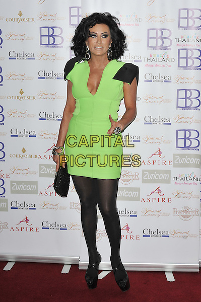 Nancy Dell'Olio.Arrivals at the Luxury and Lifestyle Awards, Porchester Hall, London, England..March 17th 2012.full length black green dress cleavage bows shoulder christian louboutin shoes bag .CAP/MAR.© Martin Harris/Capital Pictures.