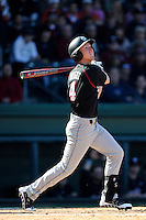 Right fielder Connor Bright (4) of the South Carolina Gamecocks hits in the Reedy River Rivalry game against the Clemson Tigers on March 1, 2014, at Fluor Field at the West End in Greenville, South Carolina. South Carolina won, 10-2.  (Tom Priddy/Four Seam Images)