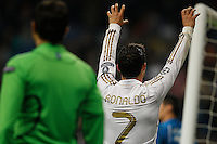 04.03.2012 SPAIN - UEFA Champions League Quarter-Final 2nd  match played between Real Madrid CF vs Apoel FC (5-2) at Santiago Bernabeu stadium. The picture show Cristiano Ronaldo (Portuguese forward of Real Madrid) celebrating his team's goal