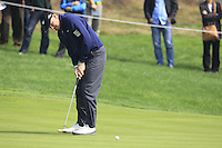Ernie Els (RSA) putts on the 5th green during Sunday's Final Round of the 2014 BMW Masters held at Lake Malaren, Shanghai, China. 2nd November 2014.<br /> Picture: Eoin Clarke www.golffile.ie