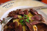 Carcassonne. At the Restaurant Auberge des Lices. Languedoc. Roast deer with polenta in a red wine and onion soup. France. Europe.