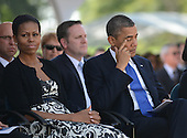 United States President Barack Obama wipes his eyes as he sits with first lady Michelle Obama during funeral services for the late U.S. Senator Daniel Inouye (Democrat of Hawaii) at the National Memorial Cemetery of the Pacific during ceremonies on Sunday, December 23, 2012. Senator Inouye was a Medal of Honor recipient and a United States Senator since 1963.   .Credit: Cory Lum / Pool via CNP