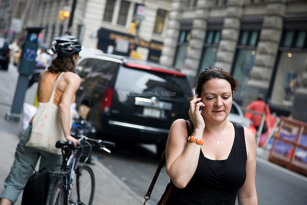 """A woman walks down 18th Street in New York City, talking on her cell phone on June 1st, 2011.  The World Health Organization (WHO) has listed mobile phone use in the same """"carcinogenic hazard"""" category as lead, engine exhaust, and chloroform, making use of cell phones a possible cancer risk."""