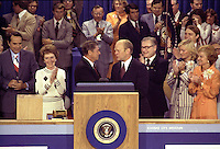 19 August 1976 - President Gerald Ford, as the Republican nominee, shakes hands with nomination foe Ronald Reagan on the closing night of the 1976 Republican National Convention. Vice-Presidential Candidate Bob Dole is on the far left, then Nancy Reagan, Governor Ronald Reagan is at the center shaking hands with President Gerald Ford, Vice-President Nelson Rockefeller is just to the right of Ford, followed by Susan Ford and First Lady Betty Ford.