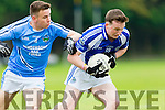 Templenoe Stephen O'Sullivan is tackled by Padraig O'Mahony Firies during the Junior SF in Beaufort on Sunday