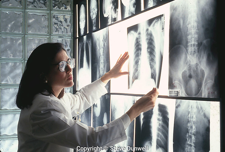 Radiologist with chest and pelvic x-rays