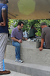 Men play chess at the chess park at North Avenue beach in Chicago, Illinois on August 18, 2008.