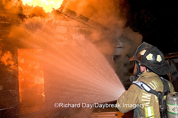 63818-020.12 Firefighter fighting house fire,  Marion Co. IL