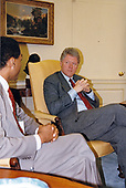 United States President Bill Clinton listens to Phill Wilson, Black Gay &amp; Lesbian Leadership Forum as he meets with representatives from several gay and lesbian organizations in the Oval Office of the White House in Washington, DC on April 16, 1993.   <br /> Credit: White House via CNP