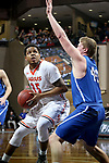 SIOUX FALLS, SD - MARCH 8:  Jamaal Murray #35 from Governors State eyes the basket against the defense of Jason Spicer #40 from Dakota Wesleyan at the 2018 NAIA DII Men's Basketball Championship at the Sanford Pentagon in Sioux Falls. (Photo by Dave Eggen/Inertia)