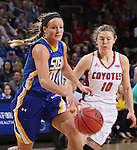 SIOUX FALLS, SD - MARCH 8:  Kerri Young #10 of South Dakota State drives past Allison Arens #10 of South Dakota during the women's championship game of the 2016 Summit League Tournament at the Denny Sanford Premier Center in Sioux Falls, S.D. (Photo by Dick Carlson/Inertia)