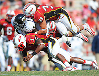 Ty Frierson of FIU is gang-tackled by the Terrapin defense. Maryland defeated FIU 42-28 during a game at Capital One Field at Byrd Stadium in College Park, MD on Saturday, September 25, 2010. Alan P. Santos/DC Sports Box