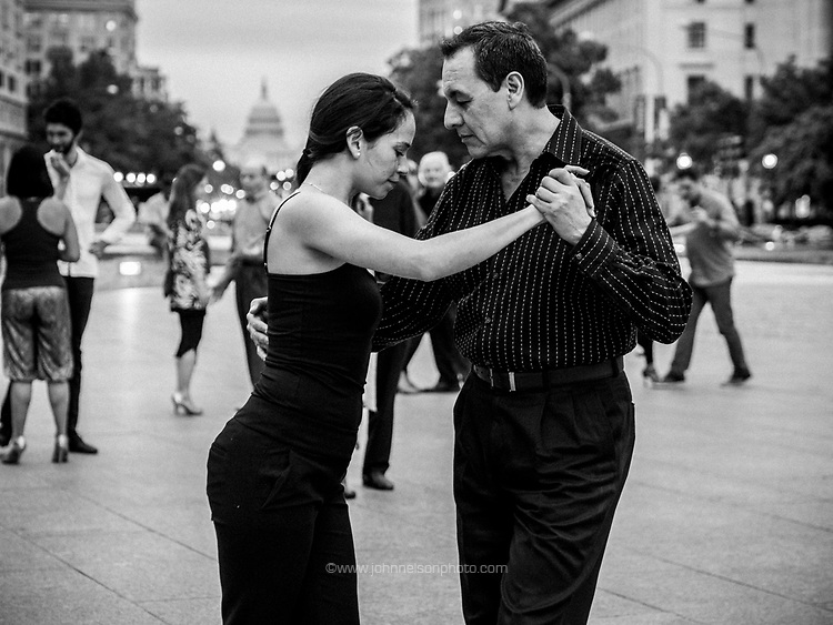 Couple dance the Tango on Freedom Plaza in Washington, DC