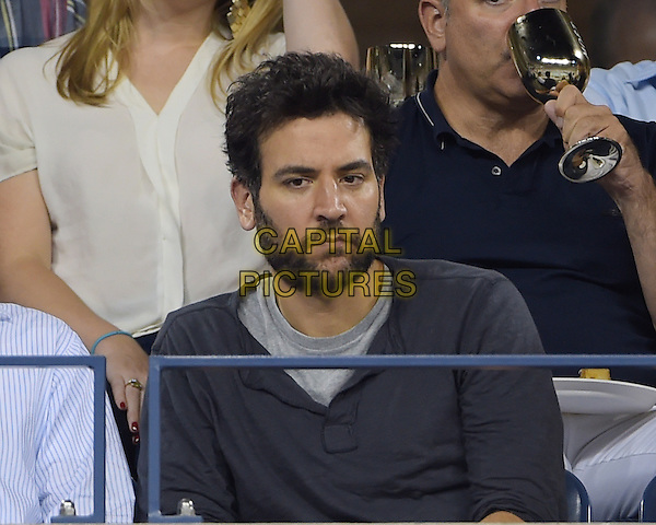 FLUSHING NY- AUGUST 30:  Josh Radnor is seen watching Eugenie Bouchard Vs Barbora Zahiavova Strycova on Arthur Ashe stadium at the USTA Billie Jean King National Tennis Center on August 30, 2014 in Flushing Queens. <br /> CAP/MPI/MPI04<br /> &copy;MPI04/MPI/Capital Pictures