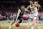 RALEIGH, NC - FEBRUARY 03: Notre Dame's Matt Farrell (5) and NC State's Omer Yurtseven (TUR) (14). The North Carolina State Wolfpack hosted the University of Notre Dame Fighting Irish on February 3, 2018 at PNC Arena in Raleigh, NC in a Division I men's college basketball game. NC State won the game 76-58.