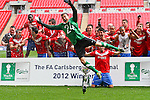 LONDON, ENGLAND - MAY 12: York City players celebrates with the trophy after winning the FA Trophy Final match between York City and Newport County at Wembley Stadium on May 12, 2012 in London, England.  (Photo by Dave Horn - Extreme Aperture Photography)