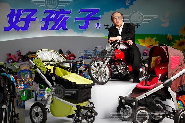 Song Zhenghuai, CEO of Goodbaby, straddles a toy motorcycle at the company's showroom in Kunshan. Goodbaby is China's largest manufacturer and supplier of infant's and children's products.