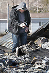 Chris Watts sobs after pulling his grandmother's coffee mug out of the rubble of her home on Saturday, Jan. 21, 2012, in Pleasant Valley, south of Reno, Nev. June Hargis, 93, was the only fatality in a wind-driven brush fire which raced through the area on Thursday destroying 29 homes. The Watts family also lost their home, barn and three horses. (AP Photo/Cathleen Allison)