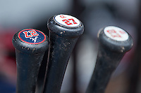 Baseball bats sit in the bat rack in the Gwinnett Braves dugout during the game against the Charlotte Knights at BB&T BallPark on July 3, 2015 in Charlotte, North Carolina.  The Braves defeated the Knights 11-4 in game one of a day-night double header.  (Brian Westerholt/Four Seam Images)