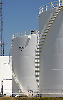 Workers inspect the top of a tank at Marathon Oil's west side loading facility Monday, June 20, 2007 in Columbus, Ohio.