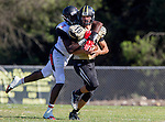 Palos Verdes, CA 09/25/15 - Daniel Schubert (Peninsula #18) and \l7\ in action during the Lawndale - Palos Verdes Peninsula Varsity football game at Peninsula High School.