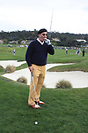 Andy Garcia with cigar on 6th hole at Pebble Beach