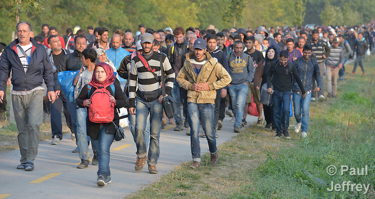 Refugees walk through the Hungarian town of Hegyeshalom on their way to a border crossing with Austria. Hundreds of thousands of refugees and migrants flowed through Hungary in 2015, on their way to western Europe from Syria, Iraq and other countries.