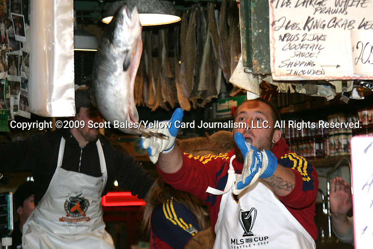 20 November 2009: Chris Seitz. Major League Soccer players Alan Gordon of the Los Angeles Galaxy and Chris Seitz of Real Salt Lake took part in a fish toss at Pike Place Market in Seattle, WA as part of the Major League Soccer MLS Cup weekend activities.