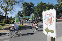 NWA Democrat-Gazette/FLIP PUTTHOFF<br /> Riders leave downtown Bentonville on Saturday Sept. 12 2015 en route to Fayetteville on the Northwest Arkansas Razorback Greenway.