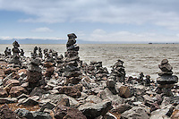 Rock Balancing - an art form or hobby.  Rocky creations rise along the rocky shores of the San Leandro Marina on San Francisco Bay