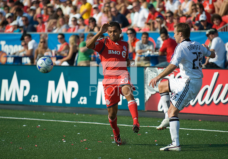 15 August 2009: Toronto FC midfielder Amado Guevara #20 and D.C. United defender Bryan Namoff #26 in action during an MLS game at BMO Field in Toronto between D.C. United and Toronto FC..Toronto FC won 2-0..Photo by Nick Turchiaro/isiphotos.com.