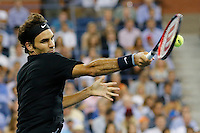 Roger Federer of Switzerland hits a return to Gael Monfils of France during their quarter-final game at the US Open 2014 tennis tournament at the USTA Billie Jean King National Center in New York.  09.04.2014. VIEWpress