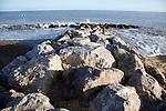 Rock groyne sea defences Felixstowe beach, Suffolk, England