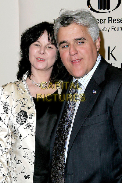 JAY LENO & WIFE MAVIS.Saks Fifth Avenue's Unforgettable Evening.Benefiting Women's Cancer Research Fund.held at the Regent Beverly Wilshire Hotel, Beverly Hills, USA, 1st March 2005..half length married husband.Ref: ADM.www.capitalpictures.com.sales@capitalpictures.com.©JWong/AdMedia/Capital Pictures .