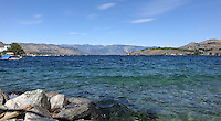 Lake Chelan is a 55-Mile long lake on the eastern slopes of the Cascade Mountains. It is known for its apples, wineries, recreation, clear water and as a summer resort destination.