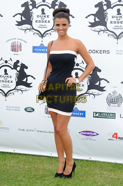 Lucy Meck.The Duke of Essex Polo Trophy at Gaynes Park, Epping, England, UK, .July 9th 2011..full length strapless white black dress hand on hip trim shoes towie.CAP/CJ.©Chris Joseph/Capital Pictures.