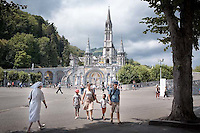 Pilgrims in the sacred area of the Sanctuary in Lourdes France