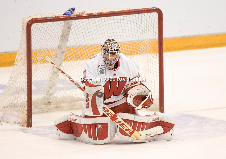 MINNEAPOLIS, MN - MARCH 26: Goalie Jesse Vetter #30 of the Wisconsin Badgers makes a save against the Minnesota Golden Gophers at Mariucci Arena during the Women's Frozen Four Tournament final on March 26, 2006 in Minneapolis, Minnesota. The Badgers beat the Gophers 3-0. (Photo by David Stluka)