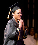 WATERBURY, CT-062017JS20- Waterbury Career Academy graduate Kathiria Mateo makes her way up on stage to receive her diploma during graduation ceremonies Tuesday at the Palace Theatre in Waterbury. <br /> Jim Shannon Republican-American